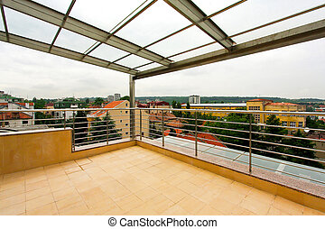 Terrace with glass roof at penthouse appartment