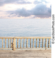 terrace view with blue sea and cloudy sky