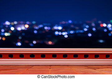 terrace with blur light in city background