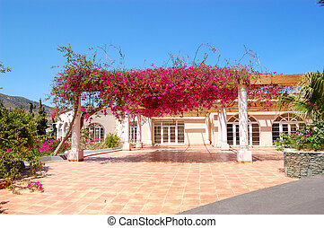 Terrace with flowers at luxury hotel, Crete, Greece