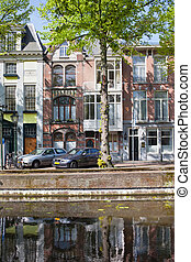 Terraced apartment buildings along canal in The Hague, South Holland, the Netherlands.