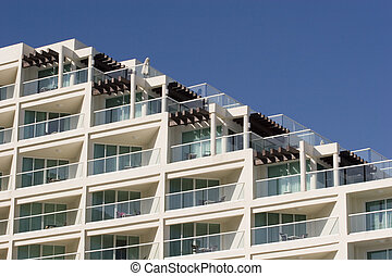 Terraced Hotel - A white luxury terraced hotel against a...