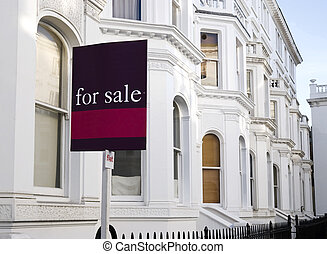 """Typical White, Luxury townhouses with """"for sale"""" sign and copy space at West-London"""