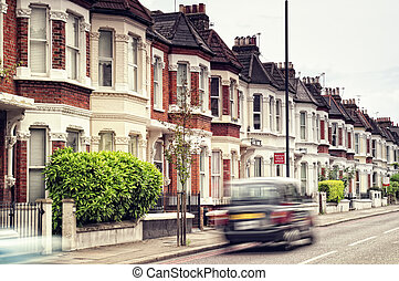 """Terraced Houses and blured \""""Black Cab\""""in Clapham ,London...."""