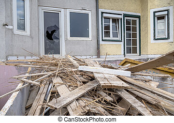 terraced houses are being renovated - older row houses are...
