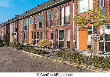 terraced houses - a row of new terraced houses in the...