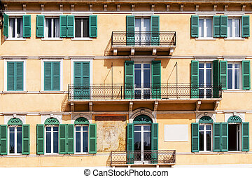 Terraces and windows of an old building in Verona
