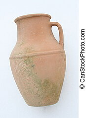 Terracotta amphora lying on a white background