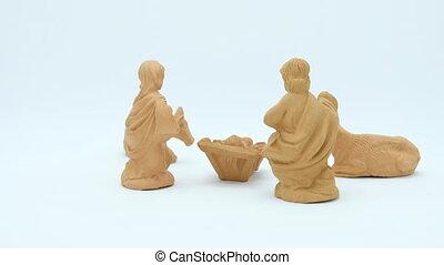 Terracotta Christian Nativity Scene on white background.
