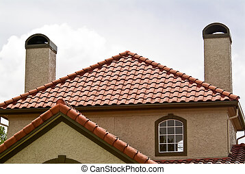 Terracotta Roof - The terracotta roof of a building with two...