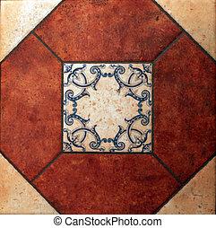 terracotta tile with blue ornate spanish pattern