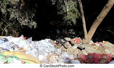 Terrible unsanitary conditions of Indian slum. The side of...