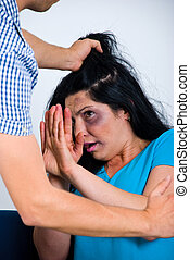 Terrified abused woman trying to stop the attack and defend herself,