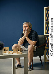 Old bearded man with alzheimer desease - Terrified and...