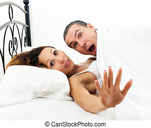 couple caught  in bed