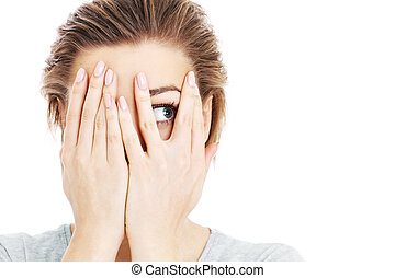 A picture of a scared woman covering her eyes over white background