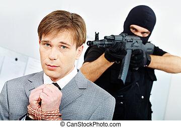 Businessman with bound hands afraid gangster