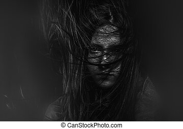 Terror, Scary, Portrait of young female beauty with long dark hair in black and white