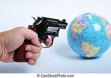 Conceptual image of a gun threatening the world suggesting terrorism