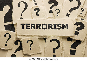 Picture of a word terrorism with question marks.