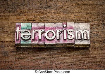 terrorism word in gritty vintage letterpress metal types