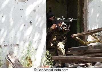 Terrorist in black mask with a gun