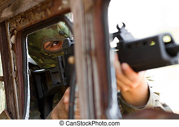 Terrorist in mask with a gun