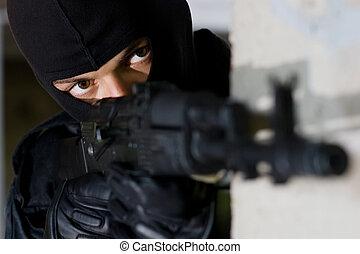 Terrorist targeting with a gun - Gunman aiming his target ...