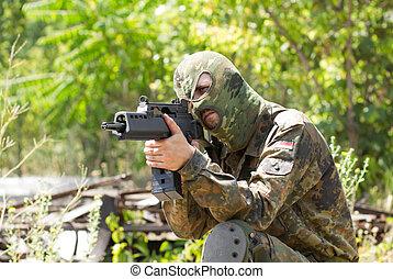 Terrorist with a gun outdoors