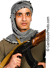 Terrorist with automatic gun and launcher on white...