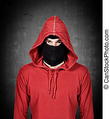 terrorist with red hoodie and mask on a white background