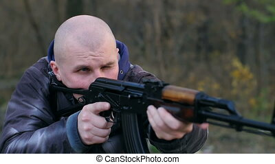 Terrorist with the gun - Bald man with AK aiming
