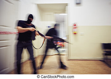 Terrorists - Two terrorists with rifles in the building -...