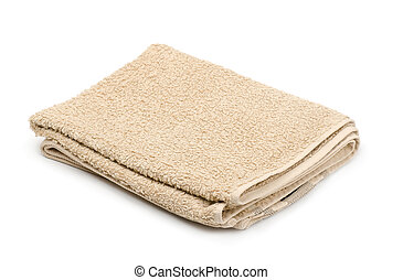Terry towel - Folded beige terry towel isolated on white