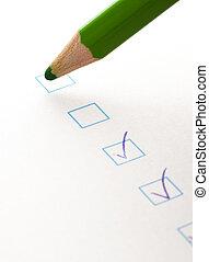 test check box and green crayon, closeup photo