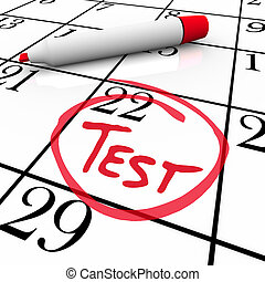 The 22nd day of the month is circled on a white calendar with a red marker with the word Test inside it, illustrating the date of an examination or exam for medical or education reasons