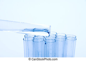 A series of test tubes being used in scientific experiments.