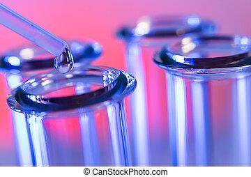 Test tubes closeup on blue background.