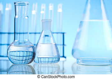 Test tubes on blue background - A laboratory is a place...