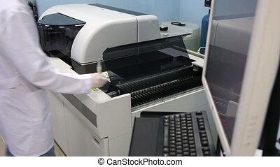 Scientist testing blood samples in laboratory