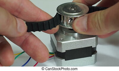 Testing Cogged Belt Pulley Stepper - Close up macro shot of...