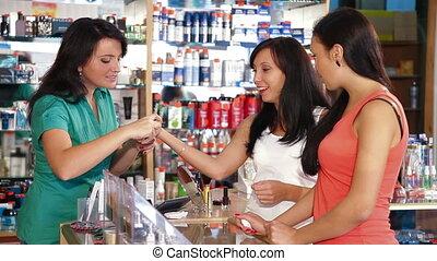 Testing Makeup Foundation - Sales representative advising a...
