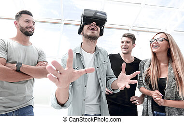 Testing new technologies. Attractive young woman in VR headset g