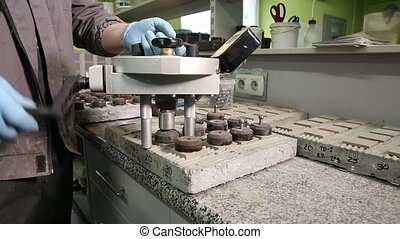 Testing of tile adhesive samples for strength - Testing of...