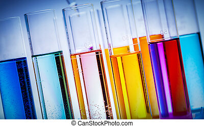 Testing tubes filled with colored substances.