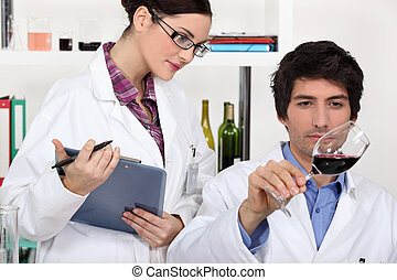Testing wine in a laboratory