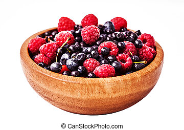 Testy fresh berries in wooden plate