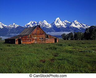 The Moulton Barn and the Teton Mountain Range in Grand Teton National Park, Wyoming.