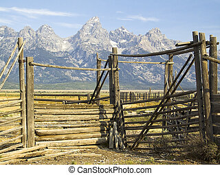 An old corral with the Grand Teton Range behind, Wyoming