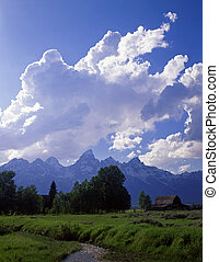 An old homestead and the Teton Mountain Range in Grand Teton National Park, Wyoming.